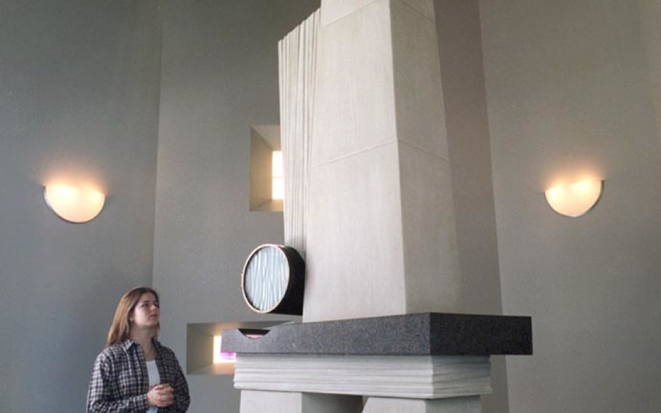 The Blessed Sacrament Chapel houses a 13-foot high limestone tabernacle with a bronze cylinder, which hovers over a granite shelf and holds the consecrated bread reserved for communion services and Viaticum.