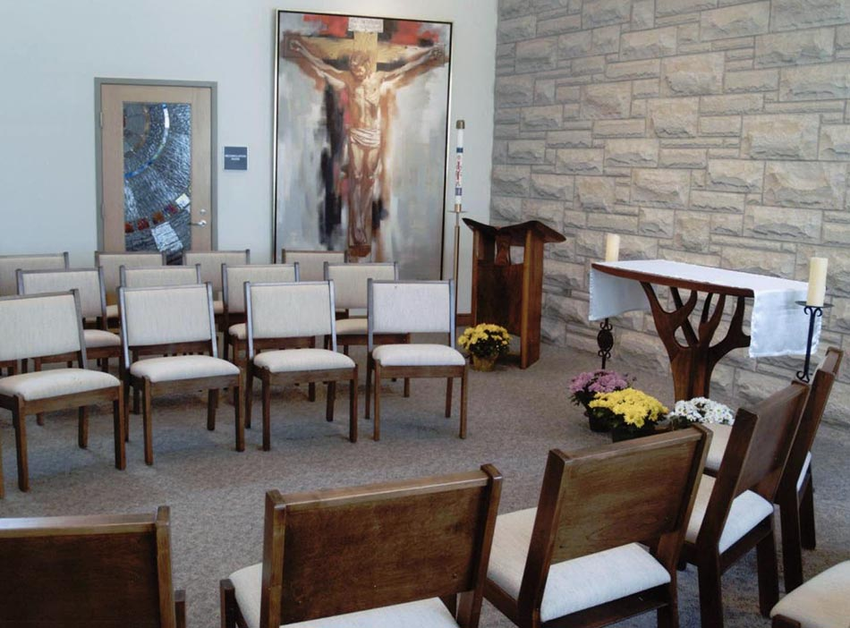 The Daily Chapel holds an eight foot high painting of the crucified Christ and the traditional Stations of the Cross, both of which are items from the Falvey Chapel, the chapel on campus that was used before the current building was constructed.