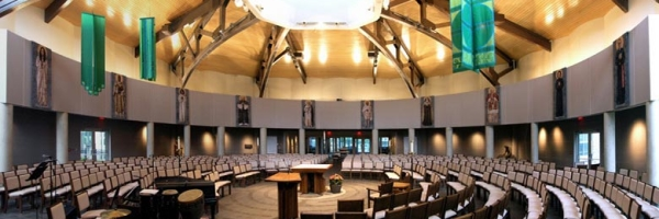 The low-ceilinged baptismal area leads into the soaring circular worship space which seats 560 people around the black walnut altar in the center, representing Christ. The ambo, which is on axis with the font and complements the altar, highlights the renewed emphasis on Scriptural proclamation and preaching.