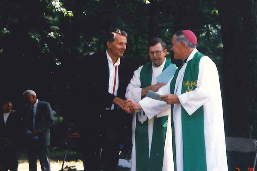 Father Dan Zak (left) with Father James Bacik and Bishop James Hoffman.