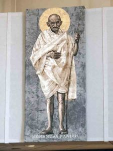 A portrait of Gandhi hangs in the Worship Space at Corpus Christi.