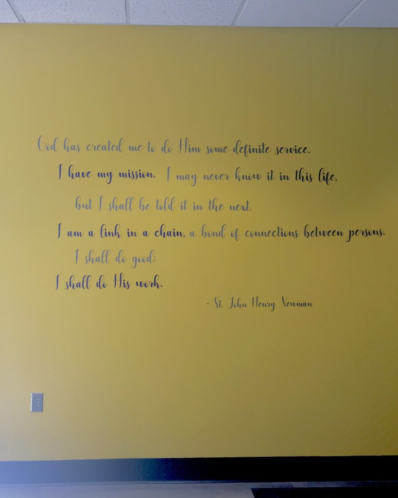 A quote from St. John Henry Newman handing in our Newman Rooms.